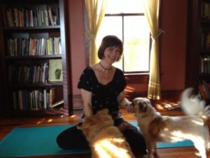 Sydney Solis and her dogs at the Mythic Yoga Studio with her new Barefoot Yoga Mat