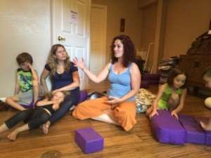 Radhika Weathers tells a story during Storytime Yoga for Kids Teacher Training Recital