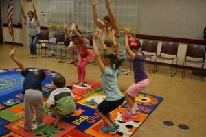 Storytime Yoga for kids in the library Debary, Florida 1 Sydney Solis storytelling and yoga