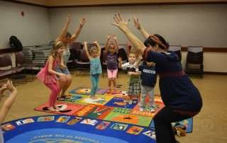 Storytime Yoga for kids in the library Debary, Florida Sydney Solis