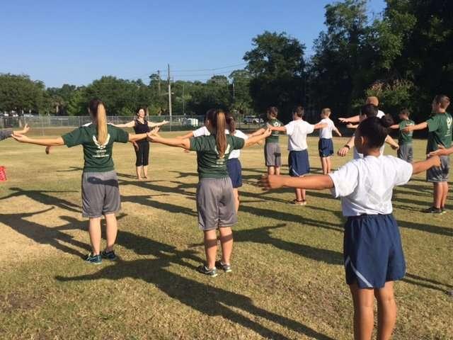 Sydney Solis teaches Yoga for physical training at AFJROTC DeLand High School